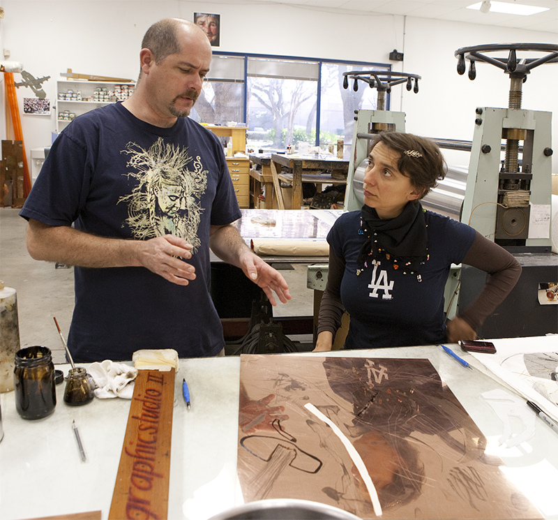 Iva Gueorguieva works with Graphicstudio's Tim Baker on an etching